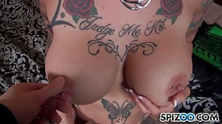 Tattooed redhead goddess with pierced nipples sucks a cock